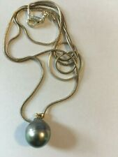 Grey Tahitian culture pearl 12mm to 13mm. 14 kt. Gold with 24 inch chain 925