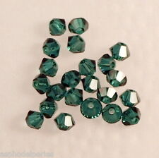 50 perles  toupies en cristal de Swarovski  5328 Emerald 3 mm
