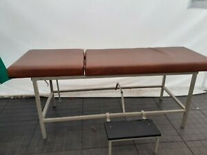 Adjustable medical/treatment/examination couch with step