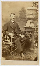 BUG EYED MAN. PAINTED BACKGROUND, TOO MANY PROPS. CDV. ALLEGHENY, PA.