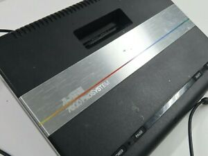 Atari 7800 Pro System console and 2 controllers, includes 8 games, works