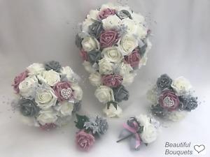 Wedding bouquets dusky pink Grey flowers Bride Bridesmaids buttonholes posy wand