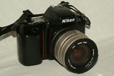 Nikon N70 camera, Sigma 28-105 mm D 1:3.8-5.6 UC-III zoom lens, batteries