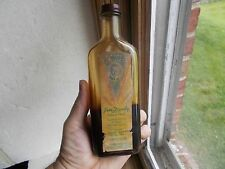 FOSTER'S JIM DANDY COMES IN HANDY LABELED BOTTLE WITH CAP THE OIL OF A 100 USES