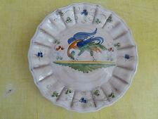 Ancienne petite assiette à décor d'oiseau, style Moustier  art populaire