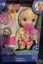 BABY ALIVE BLONDE SNACKIN LILY SNACKS W/ SIPPY CUP , PACI AND HER PUPPY.