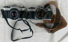 Two Vintage Canon AE-1 SLR Cameras & Lenses