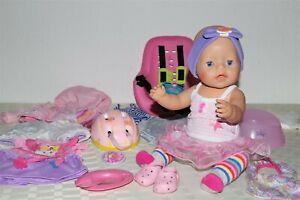 Baby Born Mädchen v. Zapf, Baby Born Fahrradsitz, Helm, viel Kleidung/Zubehör