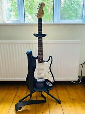 Squier Strat Electric Guitar by Fender with Amp and Stand