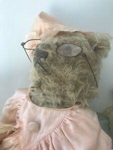 Antique 15 inch straw stuffed French bear as found as is.