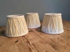 "THREE SMALL CLIP ON LAMPSHADES 5 5/8"" WIDEST X 4 3/4"" TALL"