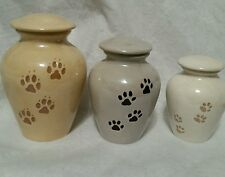 MEDIUM PAW PRINT PET URN. SHOWING 3 DIFFERENT SIZES AND COLORS. MADE IN USA