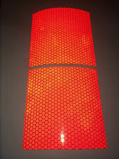 Two pieces of red high intensity reflective tape 100mm×100mm