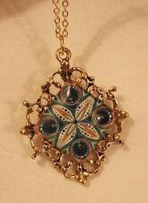 Filigree Fleur de Lis Rim Beige & Teal Peacock Feather Goldtone Pendant Necklace