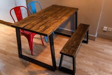 Rustic wooden dining table with industrial steel trapezium legs