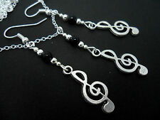 A TIBETAN SILVER MUSICAL NOTE TREBLE CLEF THEMED NECKLACE/EARRING SET. NEW.