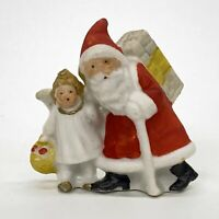 "Vintage Bisque Porcelain Santa With Snow Angel Bag of Gifts 2"" Figurine Germany"