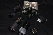 canon a1 film camera 4 lenses.