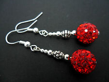 A PAIR OF DANGLY RED SHAMBALLA STYLE  EARRINGS. NEW.