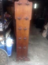 AN ANTIQUE OAK ARTS AND CRAFTS FIVE SHELVED BOOKCASE WITH ORIGINAL PEGGED ENDS.