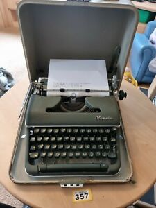 Vintage OLYMPIA Deluxe Portable Typewriter With hardcase and brush Fully Working
