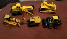 Collection of (5) 1/64 Ertl New Holland, Cat & Tonka Toy Equipment Diecast