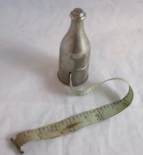 RARE ANTIQUE metal wind-up Wine bottle TAPE MEASURE opens up to hold Thimble