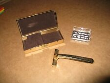 GILLETTE GOLD  COLORED SHAVER WITH 2 BLADES ENCLOSED IN GOLD COLORED BOX