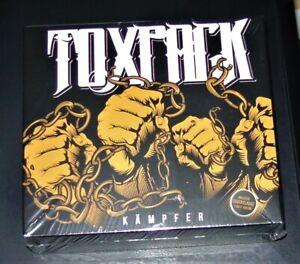 TOXPACK KÄMPFER CD IM DIGIPAK + 2 BONUS TITEL + COVER FLAGGE (100x150cm) NEU OVP