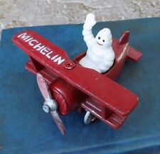 SUPERB SMALL HEAVY CAST IRON MICHELIN MAN BIBENDUM IN RED AEROPLANE BIPLANE
