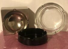 A collection of vintage ashtrays.A