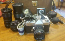 Yashica Tl-Super Camera with 4 Lenses & other Misc. Equipment in a Case