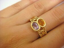 UNUSUAL FLEXIBLE LADIES RING WITH AMETHYST AND YELLOW TOPAZ 5.4 GRAMS, SIZE 6.5