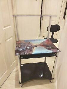 Computer desk with shelves and chair