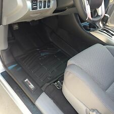 Front Row Black Floor Mats for a 2012 - 2015 Toyota Tacoma Double Cab