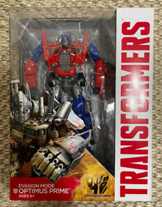 TRANSFORMERS AGE OF EXTINCTION VOYAGER CLASS EVASION MODE OPTIMUS PRIME NEW
