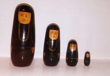 "Set of 4 Nesting dolls 6"" Woman in Black"