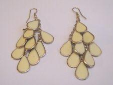 Lovely silver tone dangle style earrings teardrop design cream insert 2 ins long