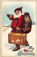 Christmas Postcard Santa Claus Carrying a Suitcase Through the Snow~108155