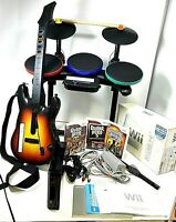 Wii console w/ Box and Manuals bundle Drums 3 Games Guitar, 2 Controllers Works