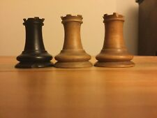 Three very unusual wooden rooks from an antique chess set