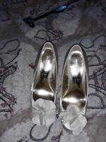 Ladies shoes size 4 used Once.with flower on front.still in box.
