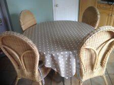 wood table with wrought iron legs & 4 wicker chairs with cushions. Conservatory.
