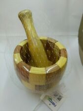 A garlic pestle and wood spices with a wonderful wooden hand Mortar and pestle
