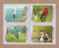 BIRDS = BLUEBIRD GREBE GANNET TANAGER Canada 1997 #1634a MNH VF Block of 4 q01