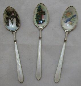 Trio Elizabeth II Sterling silver & enamel teaspoons, 1979, 34 grams