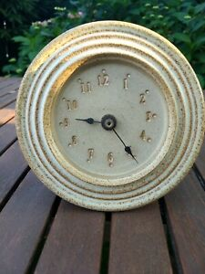 Small ceramic wall clock battery operated perfect for patio or sheltered outside