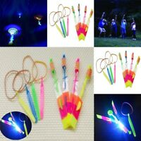 Fun Rubber Band Flying Rocket Rotating Flashing LED Light Arrow Helicopter Toy