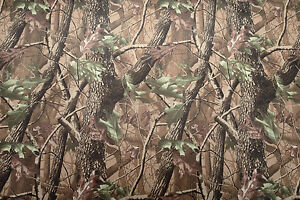 Camouflage woodland fabric in strong waterproof PVC material. 148cm x 100cm
