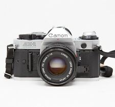 Canon AE-1 Program 35mm Manual SLR Film Camera With FD 50mm 1:1.8 Lens